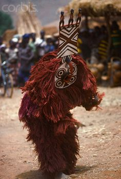 "Africa | A Bobo wears a ""Do"" mask and costume of vegetable fibre in Burkina Faso. 