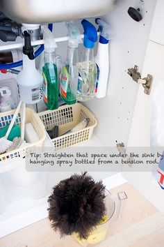 Use a tension rod under your sink to organize cleaning products.
