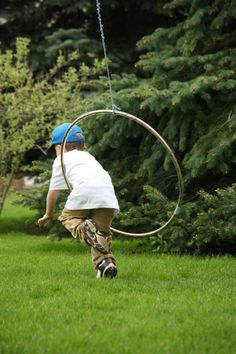 hula hoop and rope activity - hang from a branch or clothes line for open ended fun and gross motor develoopment