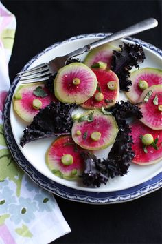 Rainbow radish and purple kale salad