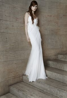 Look 8. Ivory pleated tulle mermaid gown with sweetheart neckline, cotton ribbon straps, cut-out back and godet skirt.