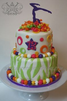 Gymnastics Cake-I need one of these with a dancer on top for Ram