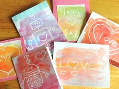 """#Watercolor Resist #Valentine's #Cards - cute and fun activity for kids. Same concept I use with drawing on Easter eggs- draw on paper with a clear/white crayon and paint over it to reveal the drawing. Kids can even send """"secret"""" messages to people by drawing on the paper with the white crayon and instructing the recipient to color over the paper to reveal the message."""