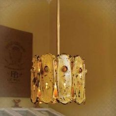 Vintage door plates transformed into a pendant light