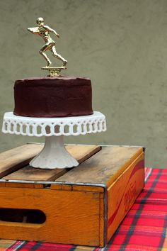 old trophy in a cake....awesome idea!!!  Gotta find more ideas to do with trophies. :)