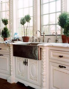 Gorgeous copper farm style sink.