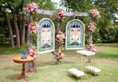 Stained glass altar with floral from Trochta's Flowers & Garden Center. Photo by Ely Fair Photography. #wedding #altar #stainedglass #colorful
