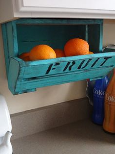 Under the cabinet fruit containers..get the basket off of the table.