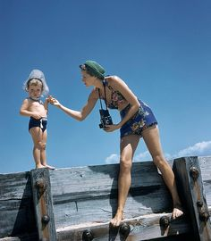 A beautiful mom and her young son enjoying a day at the beach, 1941. #summer #beach #vintage #1940s