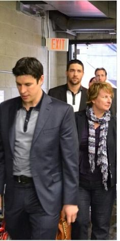 Sid and his Mom [Engelland photo bomb] on Penguins road trip with their Moms