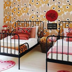 Now why couldn't I think of this? Love the wallpaper, the wrought iron beds, the color combination... guest room, bed frames, kid bedrooms, guest bedrooms, paper, iron bed, kid rooms, shared bedrooms, kiddo idea