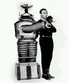 """""""Robot"""" and Dr.Smith (Jonathan Harris) from the 1960s television series """"Lost In Space""""."""