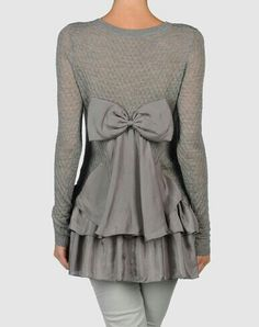 No pattern or tutorial, but would be an easy refashion by joining a sweater with monochromatic layers of satin embellished by an awesome back-bow.  Find the machines you need to refashion at Shop Joya ~ www.shopjoya.com