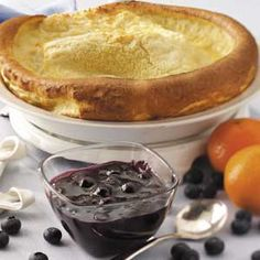 Puff Pancake with Blueberry Sauce Recipe from Taste of Home -- shared by Barbara Mohr of Millington, Michigan