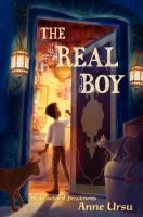"""<2013 pin> The Real Boy by Anne Ursu. SUMMARY: """"A shy boy named Oscar who works as the hand to a powerful magic worker becomes the only person who can save his village from an evil monster""""-- Provided by publisher."""