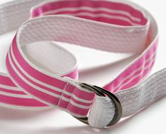 """For a double-duty, reversible soft belt, topstitch ribbon to one side of the webbing. If the webbing is lightweight, the ribbon will keep it from stretching."""