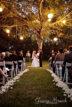 outdoor sunset ceremony in a forest or woodsy clearing with some soft lighting