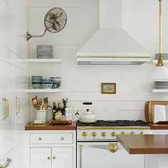 Blog | Holly Mathis Interiors Love the white, brass, fan, stove, everything!!!