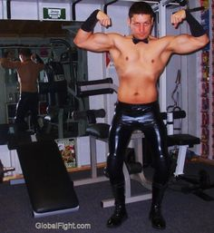 gay leather man flexing muscles