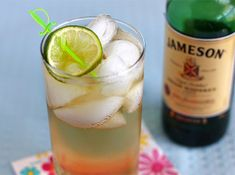 jameson-and-ginger  50 ml (1.7 ounces/3 tablespoons/1 generous shot) Jameson Irish Whiskey   Ginger ale (recommended: Vernor's)   Lime wedge   1.Fill a tall glass with ice.   2.Add the whiskey.   3.Fill the glass with ginger ale, and stir.   4.Squeeze a lime wedge over the drink, and drop it in.