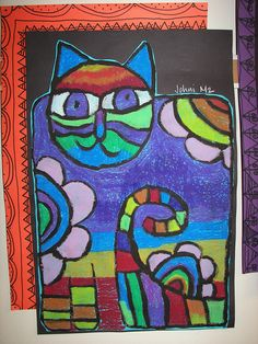 Same as other cat. This one uses oil pastel instead of paint. Cut out the shape, add to a dark background and a half frame on a colored paper made with patterns on marker.