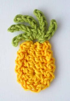 A cute pineapple fridge magnet (but I think you can use it as an applique/embelishment too). Free pattern here (UK terminology): http://www.pottagepublishing.co.uk/pineapple.html