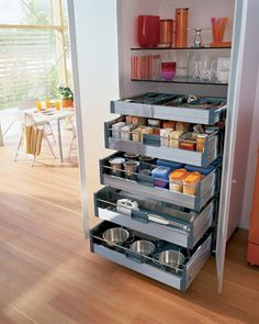 Pull-out pantry shelves, great idea for a small space. I want this when I have my own house.