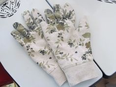 This Easy 10 Minute Garden Gloves sewing tutorial will show you how to turn an old sweatshirt into beautiful gloves for gardening. Recycle the winter blues with this cute pair of gloves for spring!