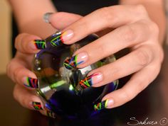 Black and multicolored French tip nails