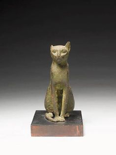 An Egyptian bronze cat. Late Period, circa 664-332 B.C.
