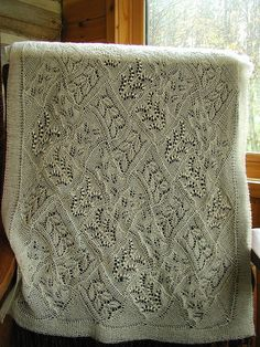 This would look beautiful as a blanket, knitted with a heavier yarn and bigger needles.  Faina Letoutchala's Forest Path stole. Knitted in cobweb wt wool/silk on size 1 needles. Lace Knitting. Myrica gale/flickr/2007.  Find the pattern via Ravelry at http://www.ravelry.com/patterns/library/forest-path-stole