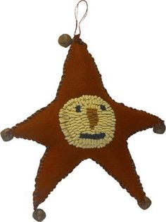 Via Hickety Pickety: Rug Hook Snowman Face on Wool Star