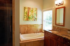 Master bathroom from the Treyburn Plan 803 http://www.dongardner.com/plan_details.aspx?pid=1809 - The master suite features back porch access, a walk-in closet, and private bath with separate tub and shower. #Small #Country #House #Design