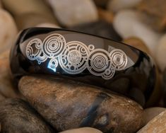 this is an Awesome Doctor Who Galifreyan Ring that we are offering on our Etsy Store: https://www.etsy.com/listing/168660333/tungsten-ring-8mm-black-dome-doctor-who?ref=shop_home_active