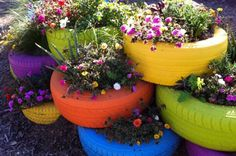 Old tires that have been painted, used as planters and turned into a lovely garden