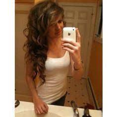 Big curls with long side bangs. she has gorgeous hair!