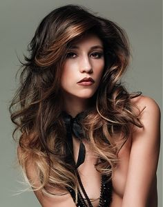 Strands of highlighted hair in a gold tone