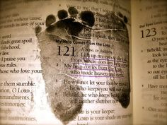 Put baby's footprints over a Scripture you prayed for him/her while you were pregnant or awaiting adoption.