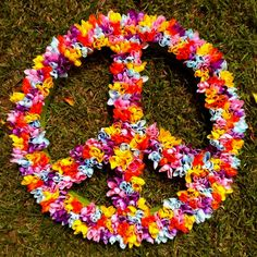 peace sign covered in plastic flowers. Perfect for bid day!