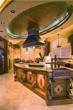 Get a load of that range hood and the huge copper grape motif ceiling medallion!