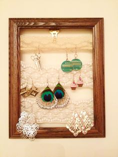 craft fair display idea: hang lace/jewelry frames from ribbon (differing lengths) tied to empty clothes rack at back of booth