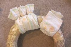 Diaper Wreath Instructions | Wrap diapers around wreath securing with rubber bands .