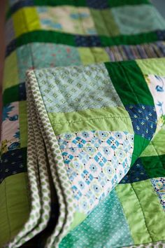 Disappearing Nine-patch patchwork quilt in fresh blue and green spring palette