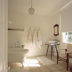 British Colonial inspired bathroom with Campaign style chair
