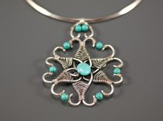 turquoise stone- wire wrapped -star- silver plated- necklace-wire wrapped jewelry handmade-wire wrapped pendant. $41.00, via Etsy.