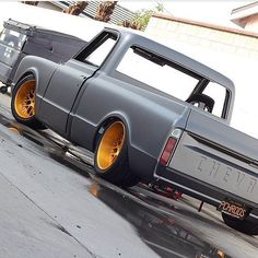 67 chevy C10 slammed matte flat black with gold mesh wheels grey