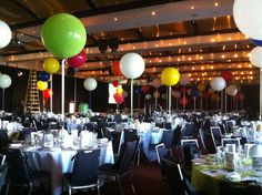 Giant 3ft balloons as table arrangements in grand ballroom