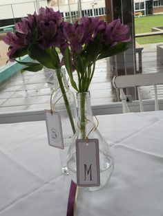 The arrangement of our engagement party! I made with my mom. All the decoration! Love this flowers, purple astromelia. I printed the tags with our initial on it and used a gold string. The jars were from my mom :) #flower #arrangement