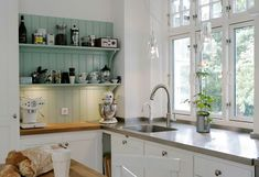 love this kitchen. are those concrete countertops? because they should be.
