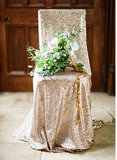 gold sequin chair cover - Read More on One Fab Day http://onefabday.com/castle-oliver-wedding-by-christina-brosnan/